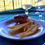 Ispinigoli - Porcetto alla brace con patate al forno.